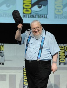 "SAN DIEGO, CA - JULY 19: Writer George R.R. Martin speaks onstage during the ""Game Of Thrones"" panel during Comic-Con International 2013 at San Diego Convention Center on July 19, 2013 in San Diego, California. (Photo by Kevin Winter/Getty Images)"