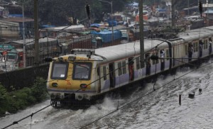 MUMBAI, INDIA - JULY 24: Mumbai local train go through the flooded railroad tracks during heavy rain showers and water logged near Kurla - Cunabhatti on July 24, 2013 IN Mumbai, India. Rail and road traffic was also disrupted due to heavy rain, which has disrupted normal life in the metropolis. The Meteorological Department has predicted more rainfall in the next 24 hours as the city of Mumbai has been receiving heavy rain since morning with very little respite. (Photo by Saroj Kumar Dora/Hindustan Times via Getty Images)