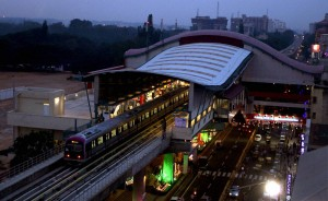 Bangalore: A Metro train on trial run on M G Road on the eve of the inauguration of the Bangalore Metro service in Bangalore on Wednesday. PTI Photo by Shailendra Bhojak(PTI10_19_2011_000117B) *** Local Caption ***